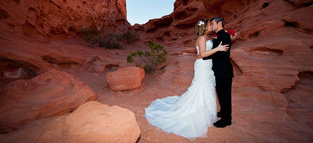 Photo Of Bride And Groom Having A Valley Fire Wedding Set Against Red Sandstone Cliffs